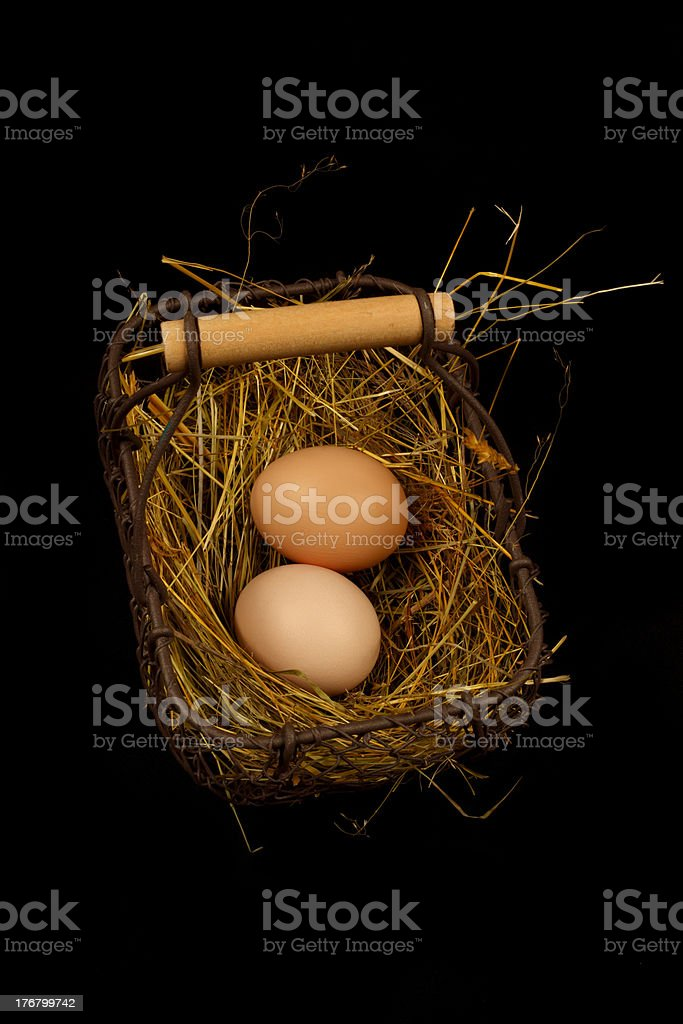 Two eggs in a basket stock photo