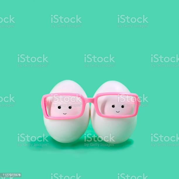 Two eggs in pink glasses like siamese twins picture id1127072378?b=1&k=6&m=1127072378&s=612x612&h=hsssy3a6kfzwfoag984zc1jii87itnbpquatw h4qtu=