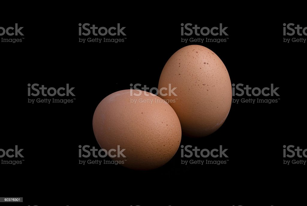 Two eggs isolated on black background royalty-free stock photo