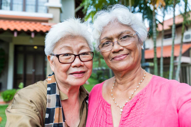Two elderly women taking a selfie together stock photo
