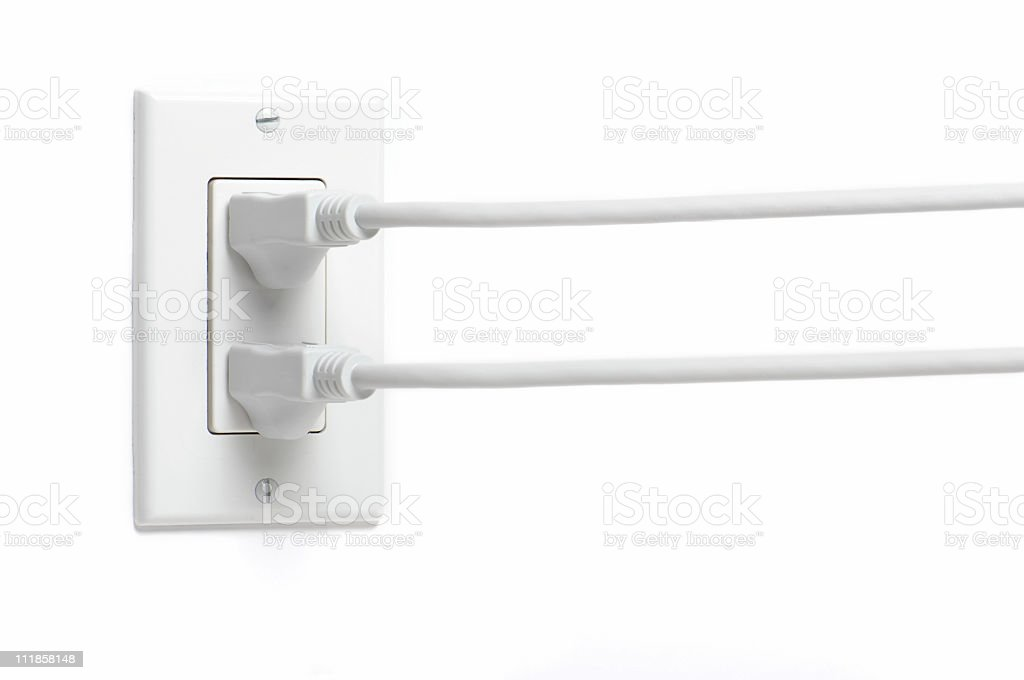 Two Electrical Cords Plugs in Socket Isolated on White Background royalty-free stock photo