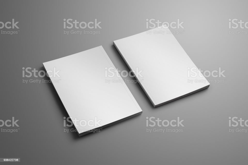 Two elegant blank closed A4, (A5) brochures with soft realistic shadows isolated on gray background. stock photo