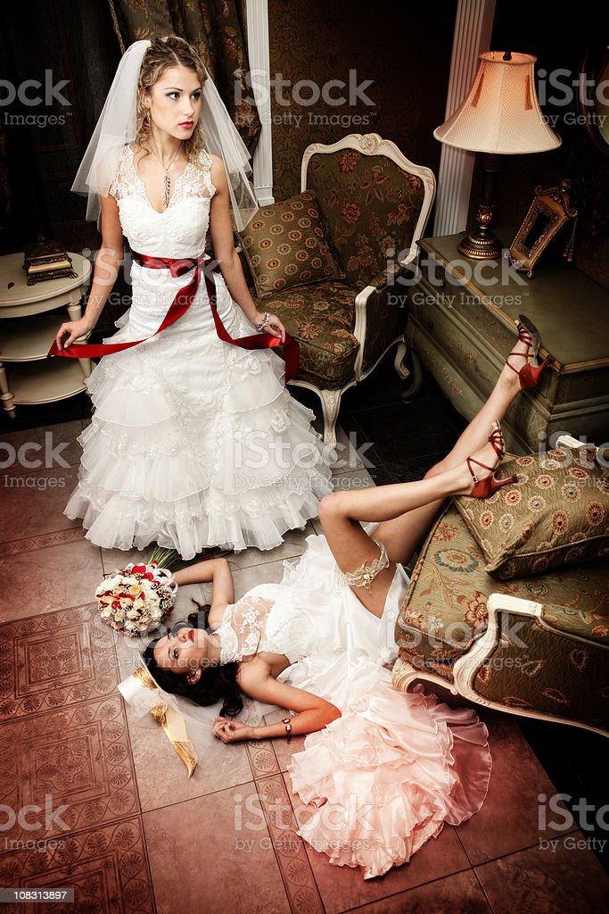 Two elegant fashion ladies in wedding dresses at  luxury interior. royalty-free stock photo