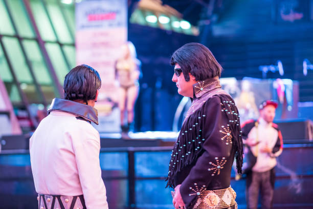 two elvis impersonators at fremont street experience, downtown las vegas - elvis stock photos and pictures