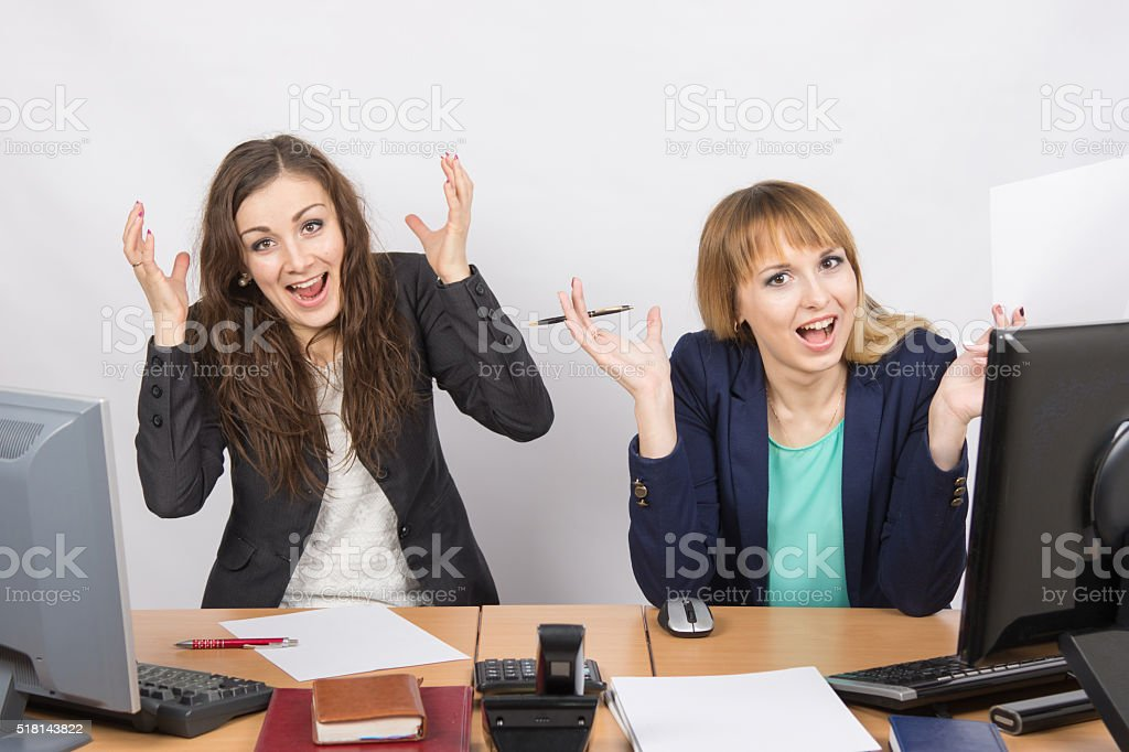 Two employee in the office expressed elation stock photo