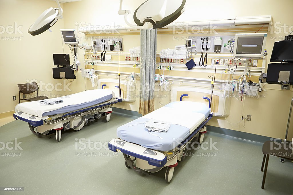 Two empty hospital beds in a emergency room stock photo