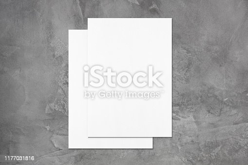 1171907064 istock photo Two empty poster mockups lying on top of each other on dark grey concrete background 1177031816