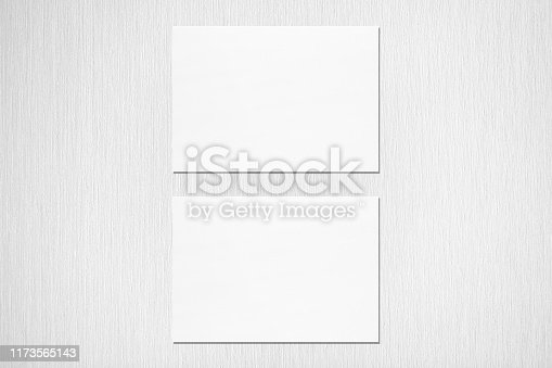 1173565159 istock photo Two empty white horizontal rectangle a5 sized card mockups on neutral light grey textured background 1173565143
