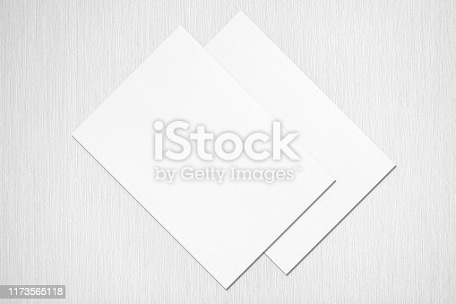 1173565159 istock photo Two empty white rectangle poster or card mockups lying diagonally on top of each other 1173565118