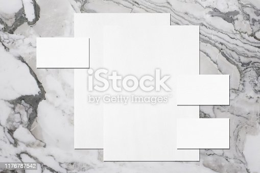 1173565159 istock photo two empty white vertical poster and three horizontal rectangle business card mockups 1176787542