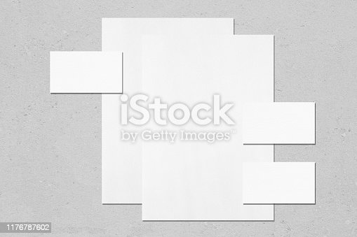 istock two empty white vertical poster and three horizontal rectangle business card mockups 1176787602