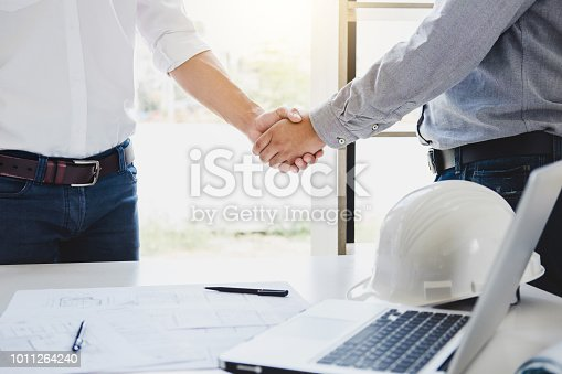 1071990712 istock photo Two engineer or architect meeting for project, handshake after consultation and conference new project plan, contract for both companies, success, partnership 1011264240