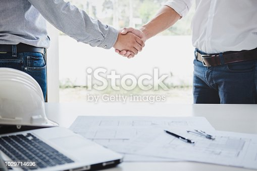 1071990712 istock photo Two engineer or architect meeting for project, handshake after consultation and conference new project plan, contract for both companies, success, partnership 1029714696