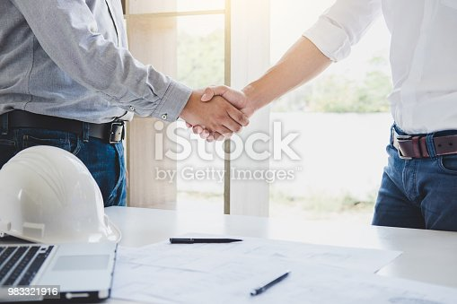 1071990712 istock photo Two engineer or architect meeting for project, handshake after consultation and conference new project plan, contract for both companies, success, partnership 983321916