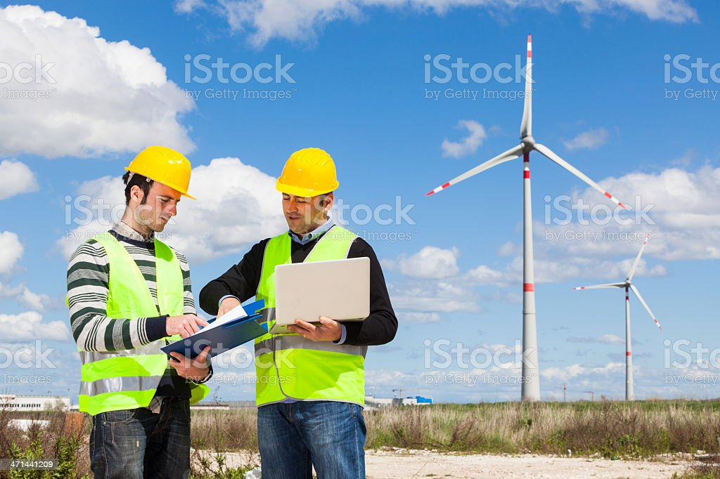 Two Engineers at Work in Wind Turbine Power Station stock photo
