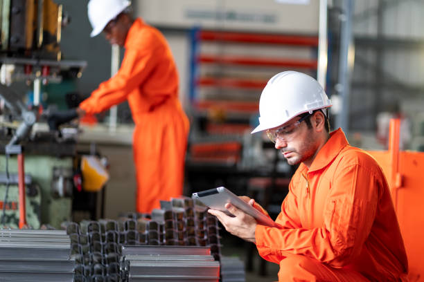 Two engineers checking information on a tablet. stock photo