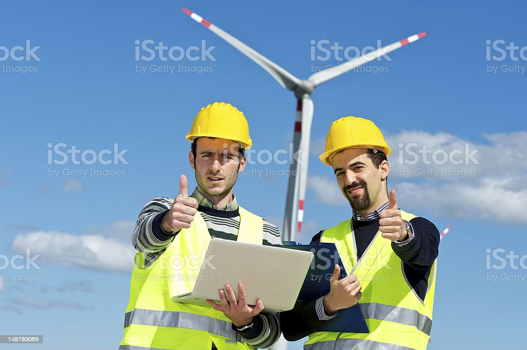 Two Engineers in a Wind Turbine Power Station royalty-free stock photo