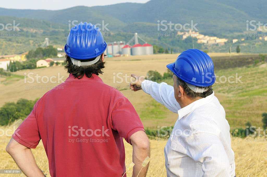 Two Engineers in the Countryside royalty-free stock photo