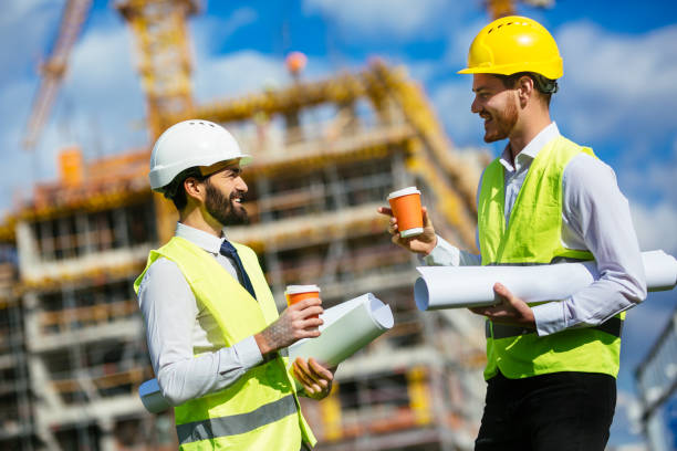 Two engineers on a coffee break stock photo