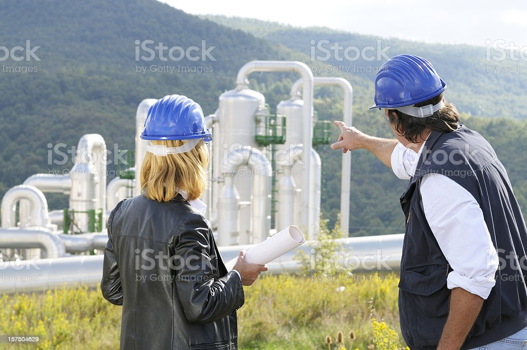 Two Engineers Planning in Geothermal Power Station royalty-free stock photo