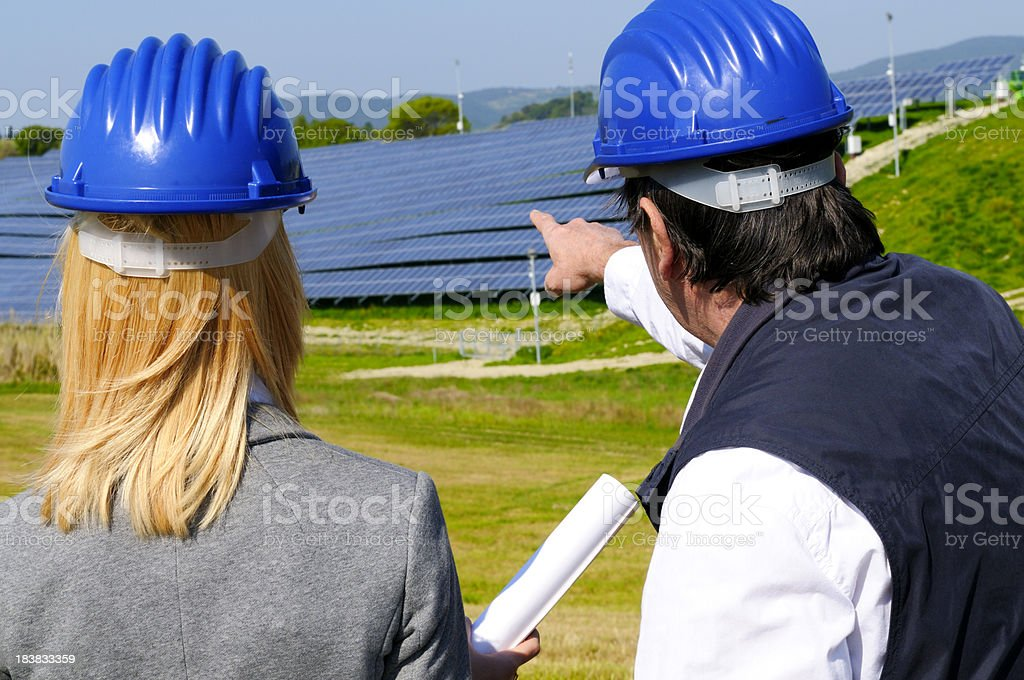 Two Engineers Planning in Solar Power Station royalty-free stock photo