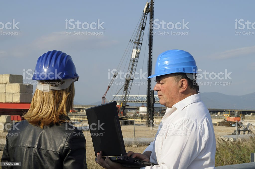 Two Engineers Planning PC Highway Construction Site royalty-free stock photo