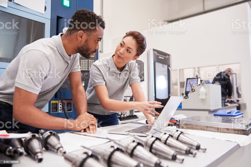 Two Engineers Using CAD Programming Software On Laptop foto stock royalty-free
