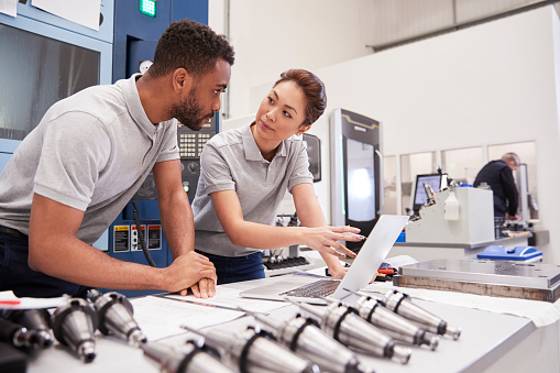 istock Two Engineers Using CAD Programming Software On Laptop 946236688