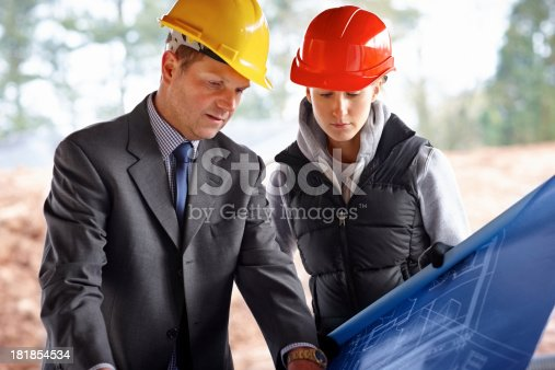 istock Two engineers working on a project 181854534