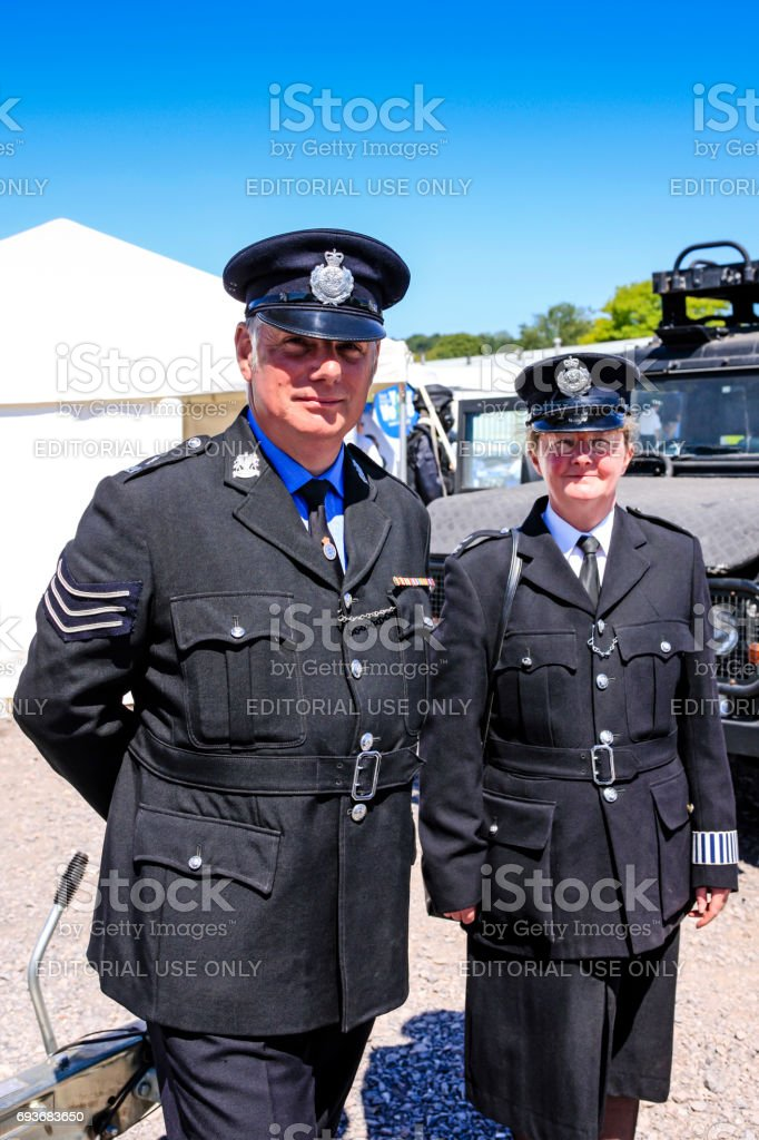 Two English Police Officers in 1960s Uniforms at the Bath and West show in Somerset, UK stock photo