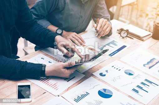 885956164istockphoto Two entrepreneur person working and colleague analyzing data for new start-up business and marketing. 885956024
