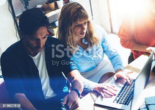 912675036 istock photo Two entrepreneurs are looking for a business solution during work process at sunny office.Business people meeting concept.Blurred background.Horizontal. 919607816
