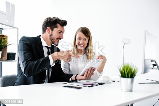 557608497istockphoto Two entrepreneurs sitting together working in an office 1016109186