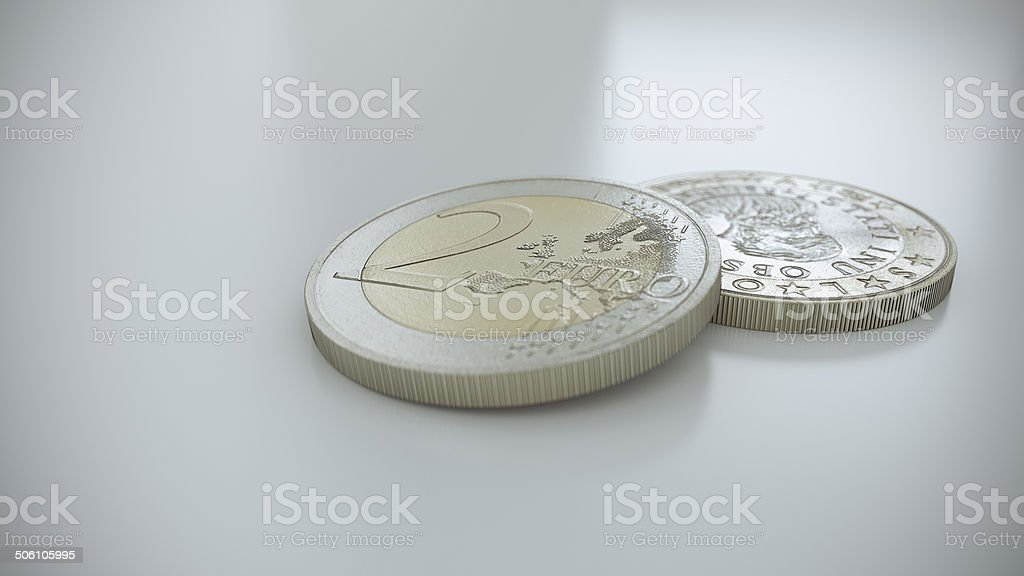 Two Euro coins on a white reflective surface stock photo