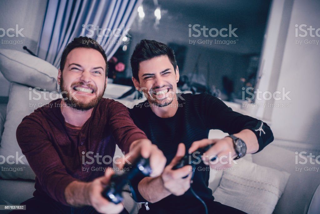 Two Excited Friends Playing Video Games stock photo