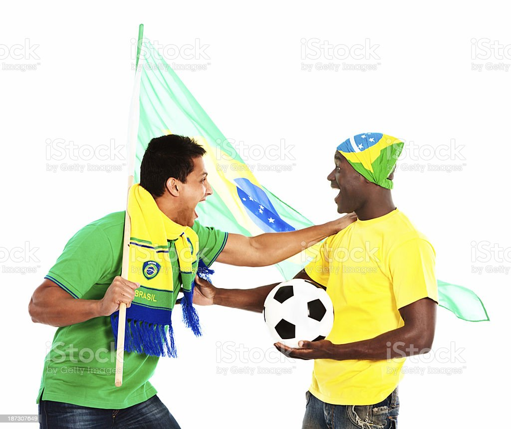 Two excited male soccer fans wave the Brazilian flag royalty-free stock photo