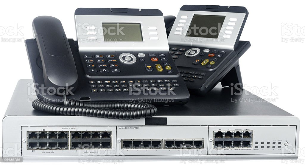Two executive telephones with a silver phone switch royalty-free stock photo
