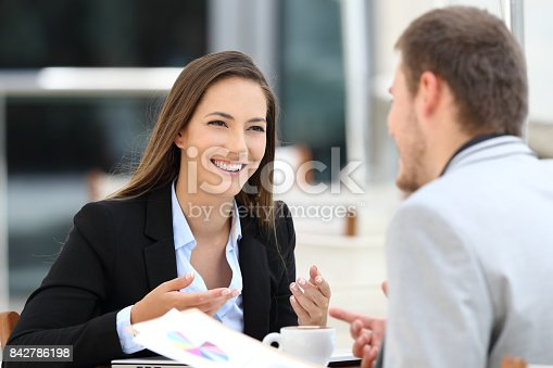 istock Two executives having a business conversation in a bar 842786198