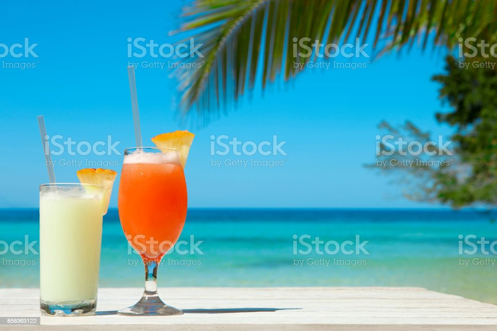 Two Exotic Cocktails At The Beach stock photo