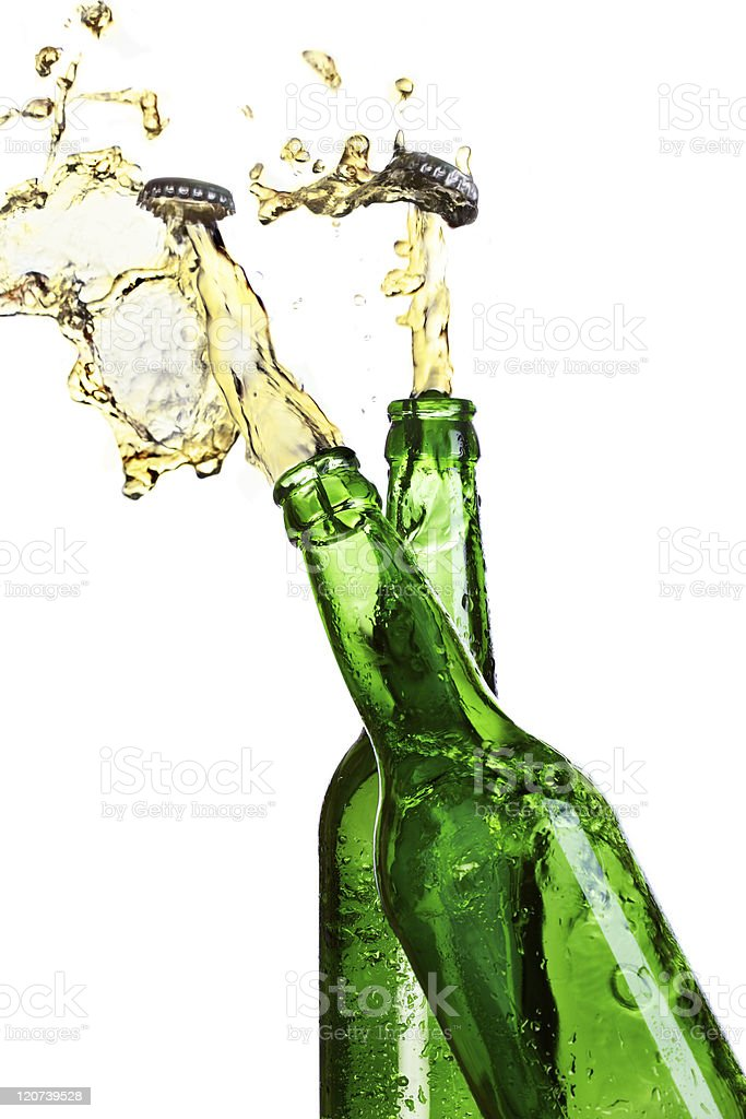 Two exploding beer bottles stock photo