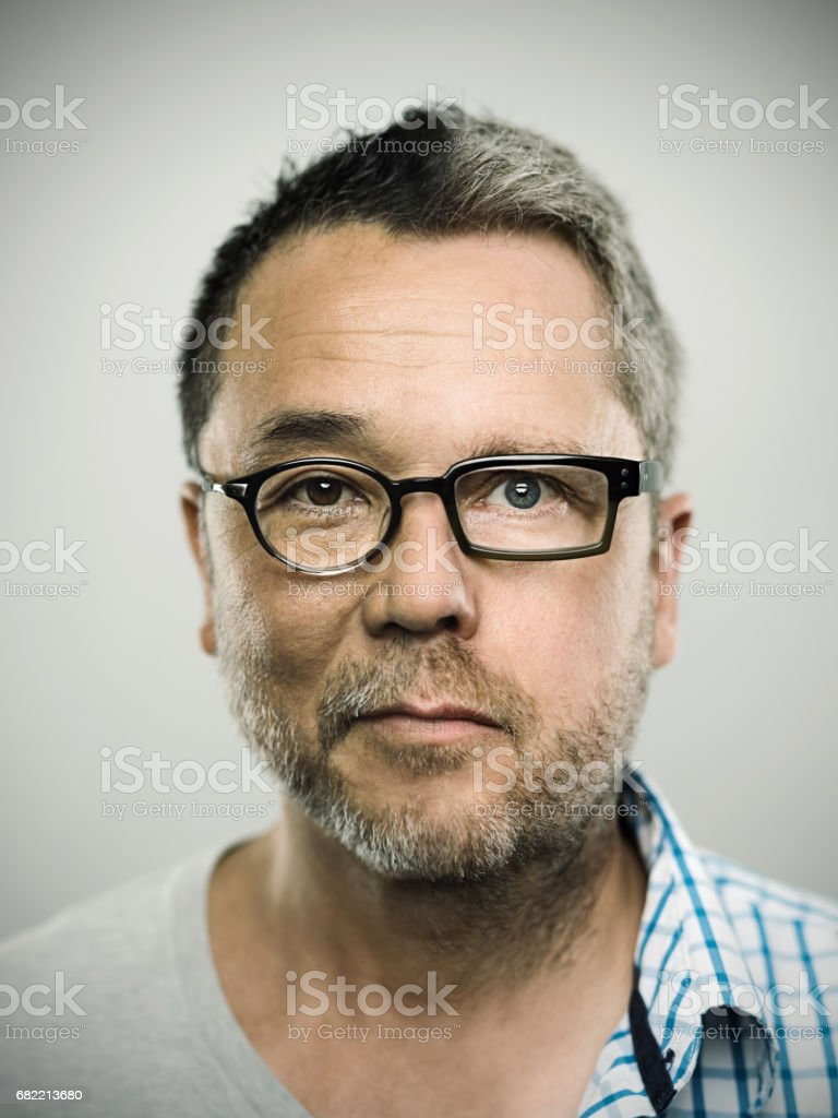 Two faced man against gray background stock photo