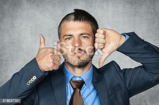 istock two facial businessman can not decide 518037201