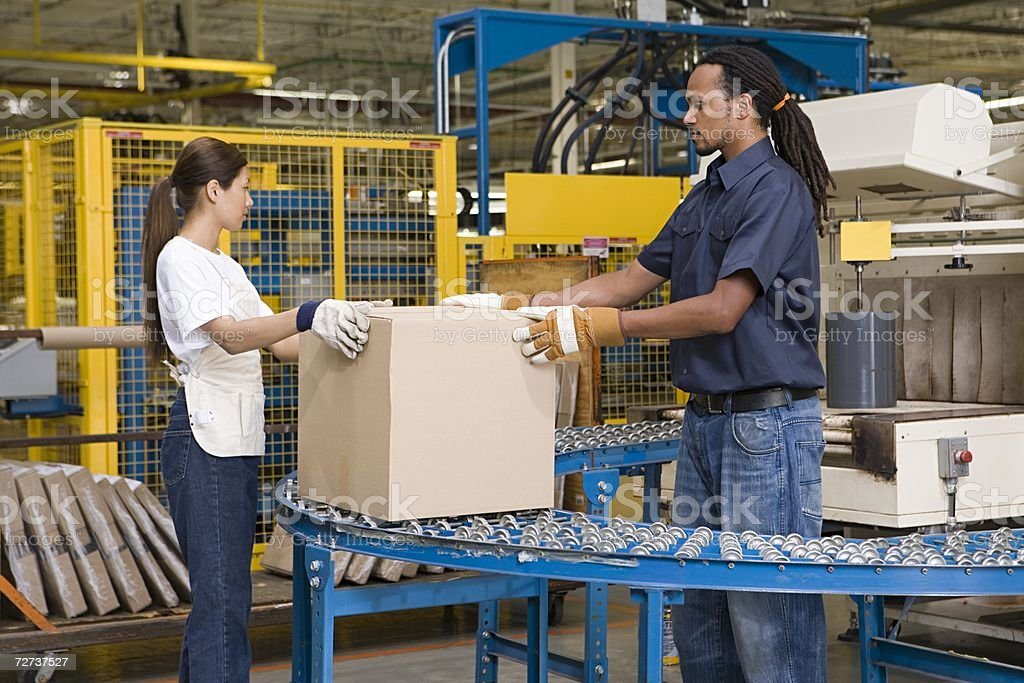 Two factory workers stock photo