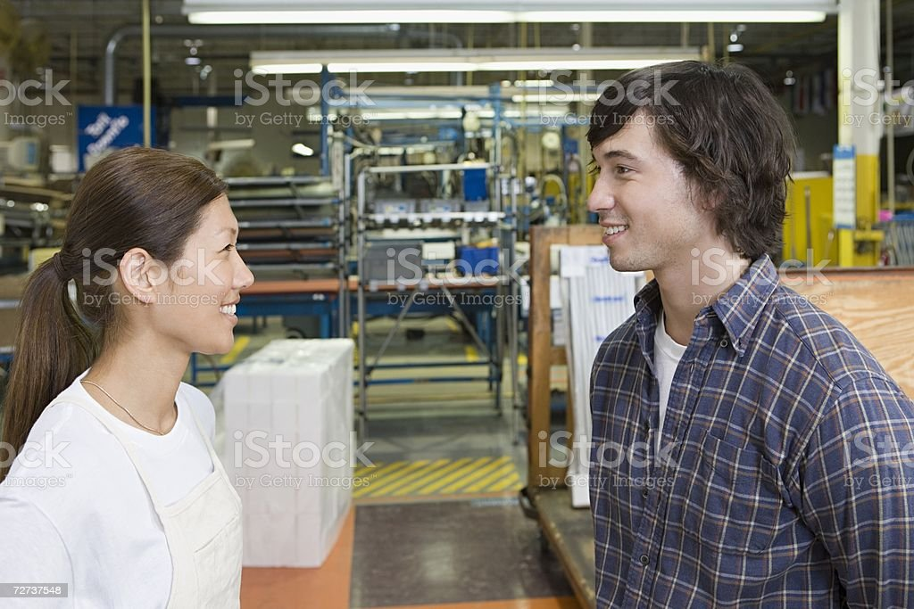 Two factory workers smiling stock photo