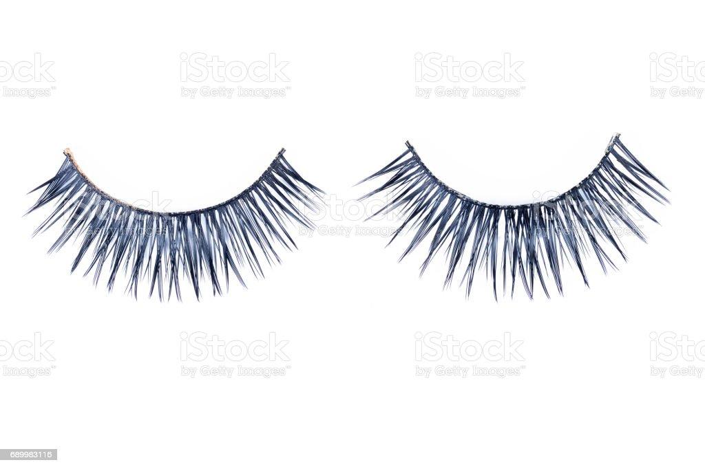 Two false black eyelashes isolated on white. stock photo