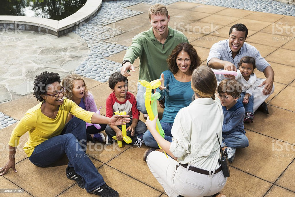 Two families at a park stock photo