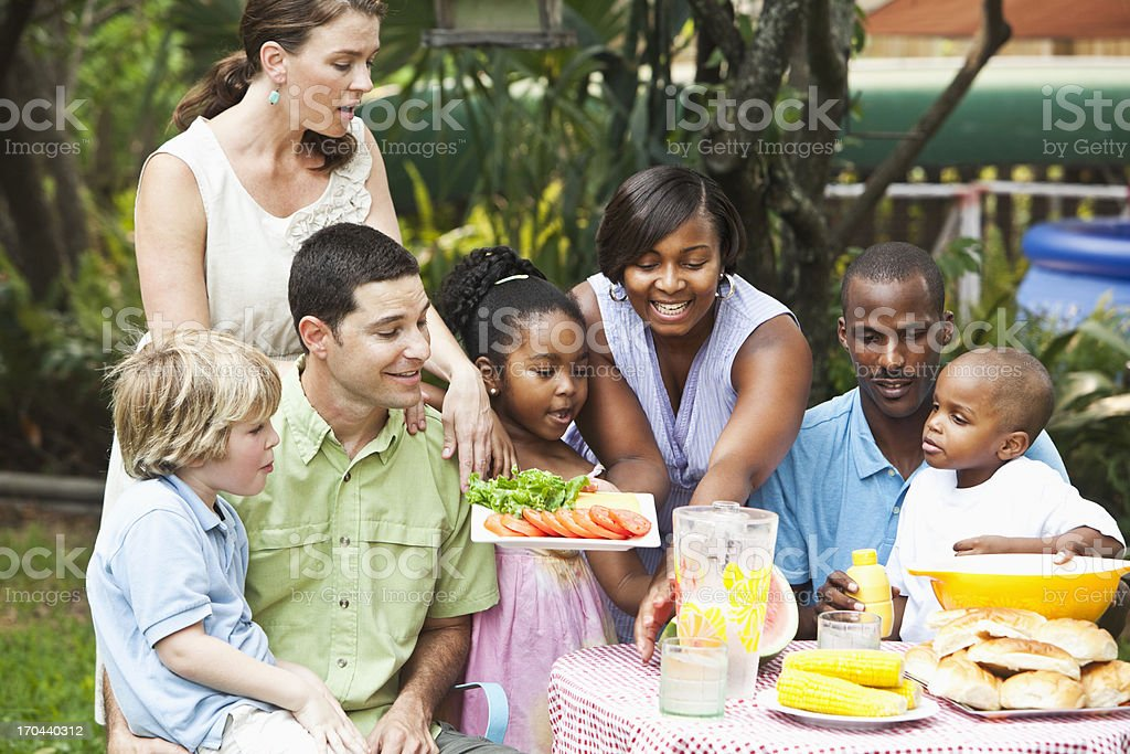 Two families at backyard cookout stock photo