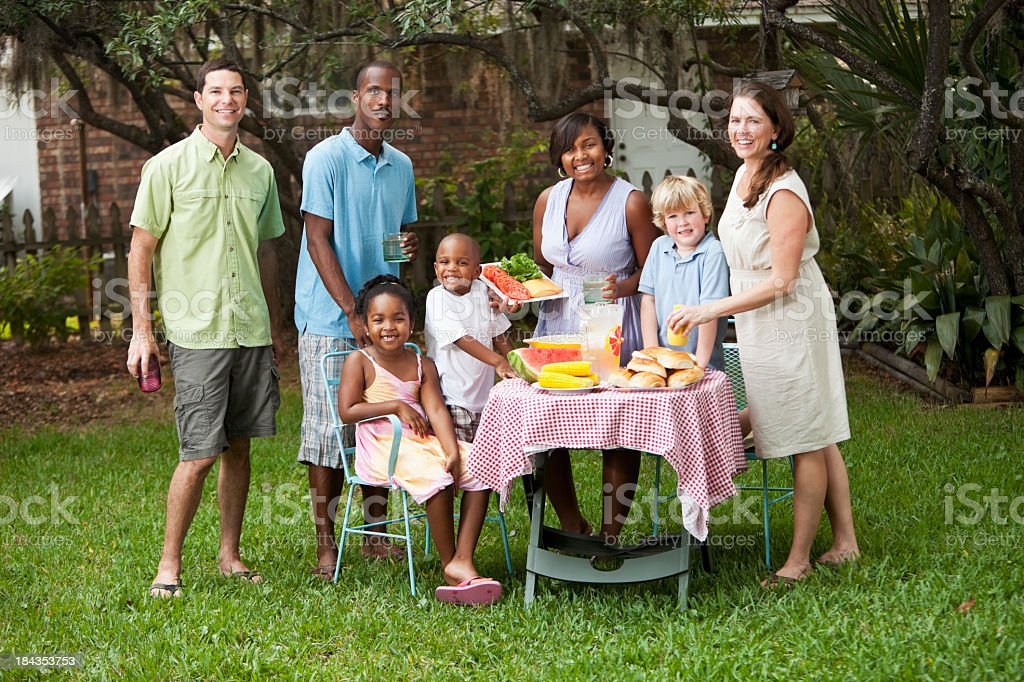 Two families at backyard cookout royalty-free stock photo