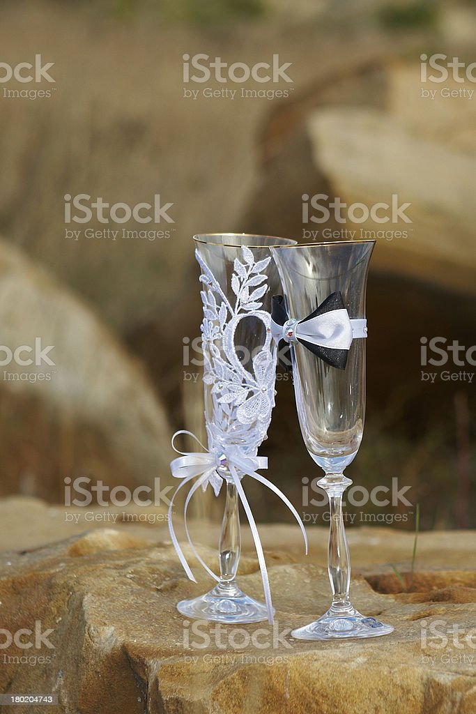 Two fancy wedding goblets glasses on tender background royalty-free stock photo