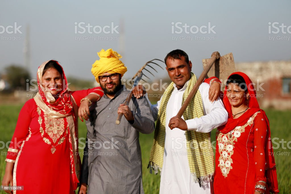 Two farmer standing portrait with their wife stock photo